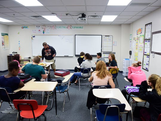 Teacher Eric Struck speaks to students in his classroom