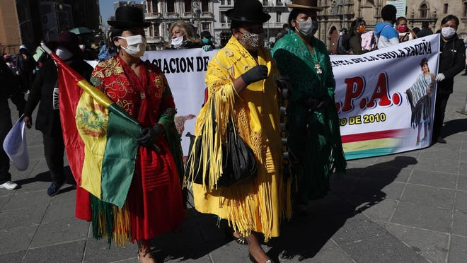 Indigenous women known as Cholitas wear face masks amid the spread of the new coronavirus as they protest the government's recent closing of the Culture Ministry, demanding it reopens in La Paz, Bolivia, Monday, June 15, 2020. The government closed the ministries of culture, sports, and communication, citing the need to cut costs.