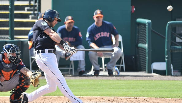 Tigers' Andrew Romine hits a home run in the third