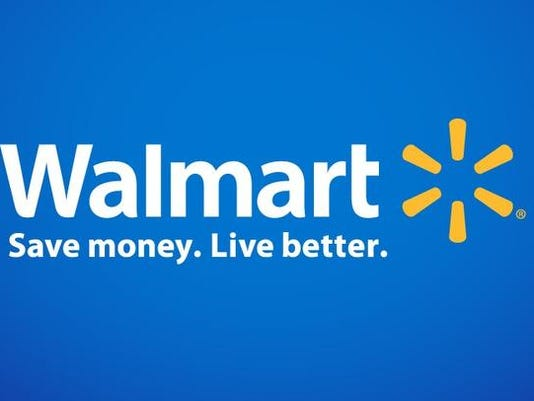 Wal-Mart's profit shrinks 21 percent, will speed up growth plans