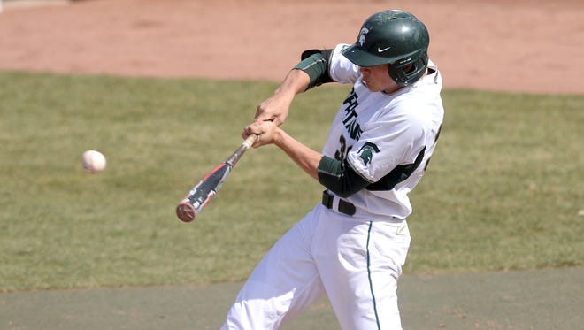 Michigan State's Cam Gibson connects for a hit against Western Michigan in April 2014.