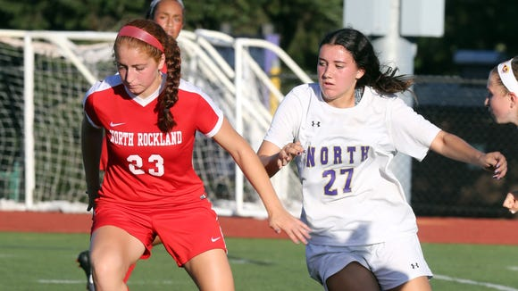 Clarkstown North's Jessica Reck (27) and North Rockland's