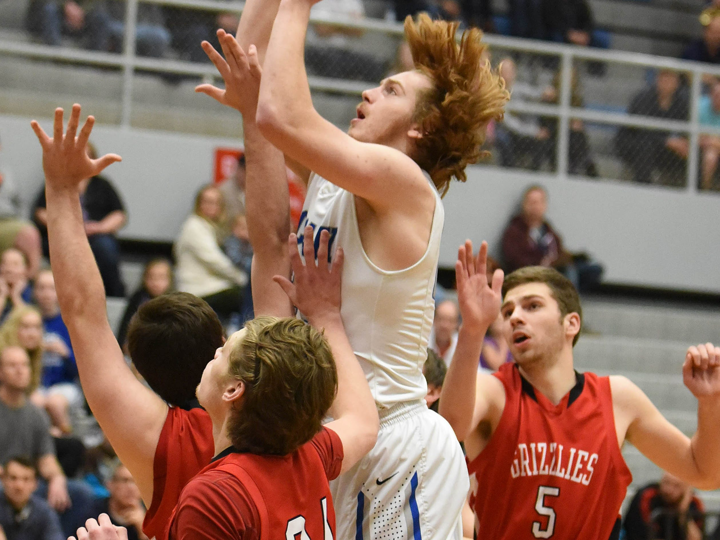 McNary's Tregg Peterson and the Celts take on McMinnville in a Greater Valley Conference game on Friday, Feb. 13, 2015.