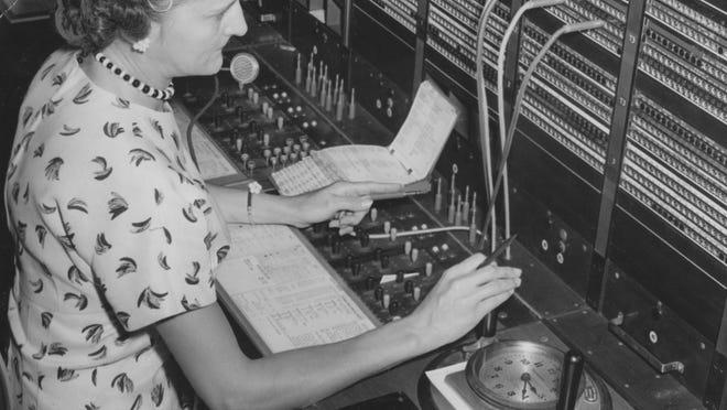 Indiana Bell Telephone operator Martha Bennett uses a telephone switchboard.