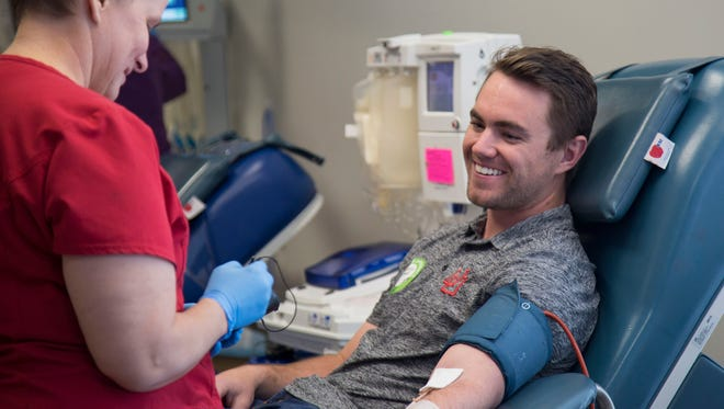 Zachary Sterbens donates blood at the Salt Lake Donor Center. He first started donating blood with his father five years ago.