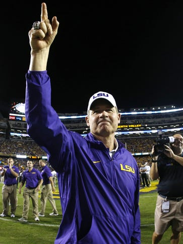 LSU coach Les Miles acknowledges the Tiger Stadium