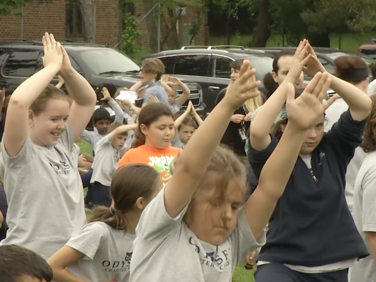 Students at Odyssey Charter School celebrated with outdoor activities Tuesday morning after raising $16,845 for the American Heart Association in May.