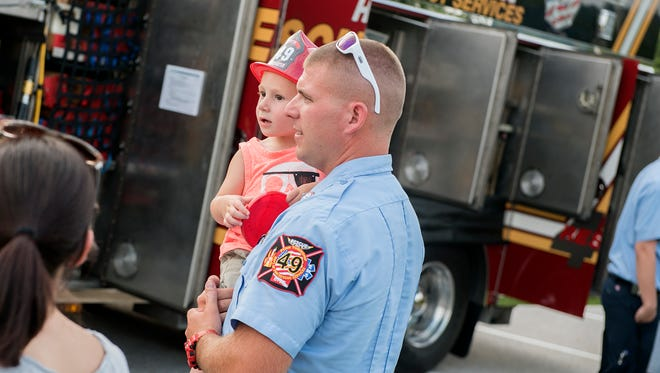 Zack McNeil of Penn Township holds his son, Carter, 2, during National Night Out in 2017. National Night Out is a community-building campaign that promotes police-community partnerships and neighborhood camaraderie.