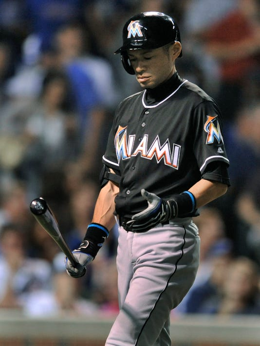 Miami Marlins' Ichiro Suzuki reacts after lining out during the seventh inning of a baseball game against the Chicago Cubs, Monday, Aug. 1, 2016, in Chicago. Chicago won 5-0. (AP Photo/Paul Beaty)