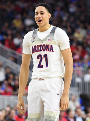 Arizona center Chance Comanche (21) reacts to a call during a Pac-12 Conference Tournament game against the UCLA Bruins at T-Mobile Arena.