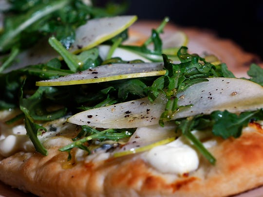 The pear and arugula flat bread pizza from Chef David