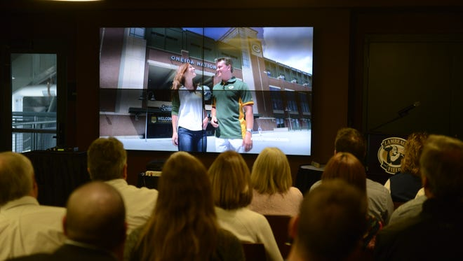"Guests watch the premier of Discover Wisconsin's ""Green Bay - The Football City"" Tuesday, April 12, 2016, at Lambeau Field."