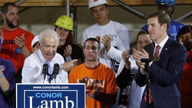 In this March 6, 2018, photo, former Vice President Joe Biden points at Conor Lamb, right, the Democratic candidate for the March 13 special election in Pennsylvania's 18th Congressional District, during a rally at the Carpenter's Training Center in Collier, Pa. Fighting to stave off another special election embarrassment, the White House is strengthening its final-days offensive in western Pennsylvania. (AP Photo/Gene J. Puskar)