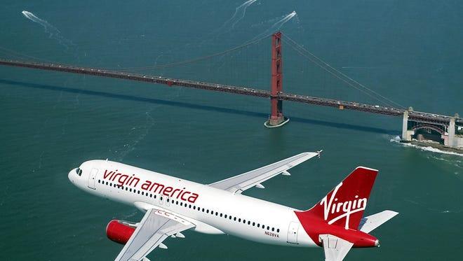 Virgin America Airbus 320 flies over the Golden Gate Bridge in San Francisco.