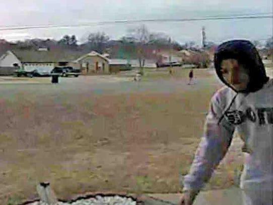 Video surveillance shows a porch bandit stealing Christmas