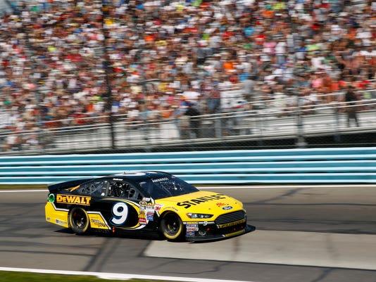 Marcos Ambrose (9) drives during a NASCAR Sprint Cup Series auto race at Watkins Glen International, Sunday, Aug. 10, 2014, in Watkins Glen N.Y. (AP Photo/Mel Evans)