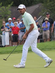 Australian Curtis Luck watches his putt just miss on