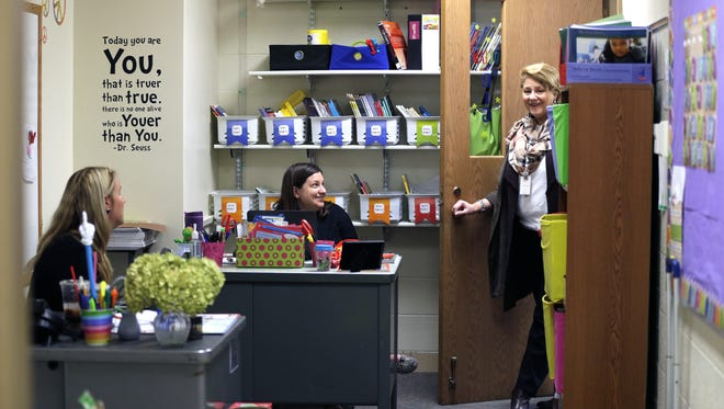 English Language Learner teachers Mallory Blozinski, Vikki VanEgeren and Amy Ashwood talk with each other in a shared office space at Eisenhower Elementary School in Green Bay. The Green Bay School District is hoping to upgrade and expand some of its school buildings to ease overcrowding and other facility issues.