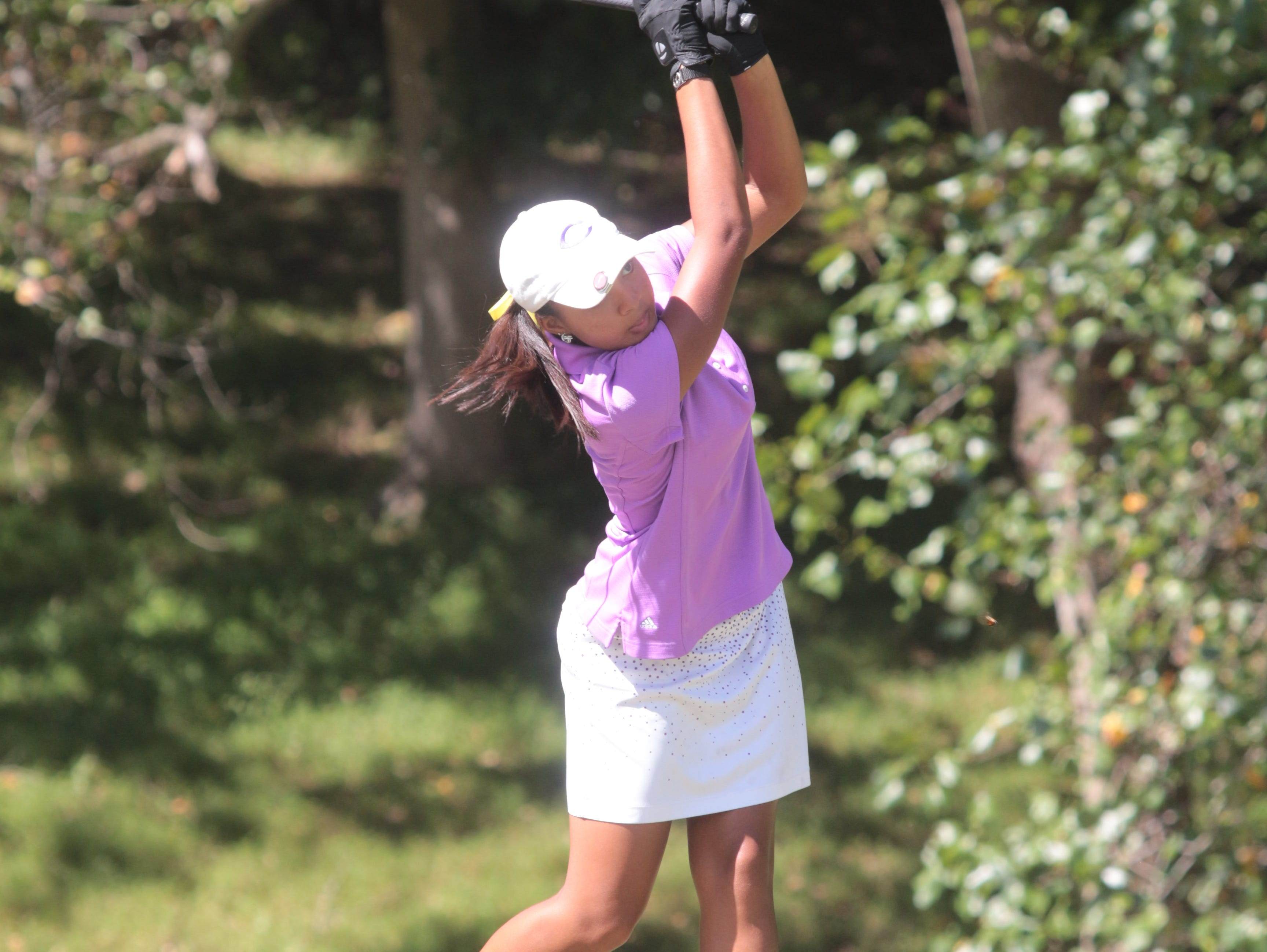 Clarksville High's Mariah Smith tees off on the final hole during the Region 5-AAA Golf Tournament Monday at Swan Lake. CHS captured the region title by one stroke.
