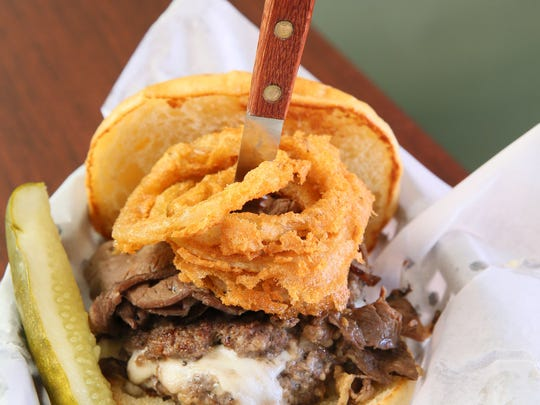 One of the Crafty Cow's signature burgers is The Beast,