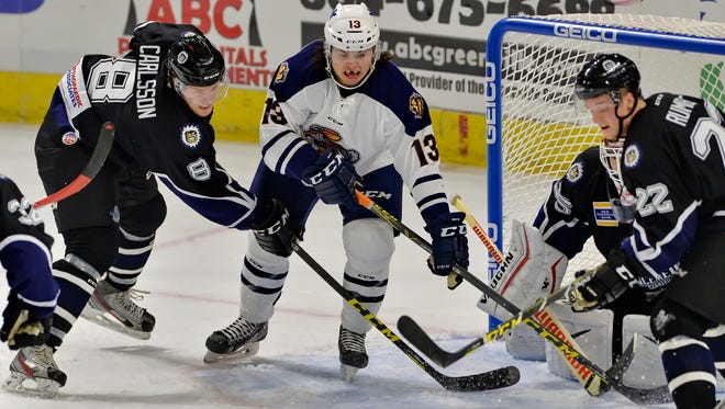Greenville's Emerson Clark works in front of the Evansville IceMen's goal on Saturday.