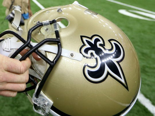 Saints defensive end Mitchell Loewen helped an injured