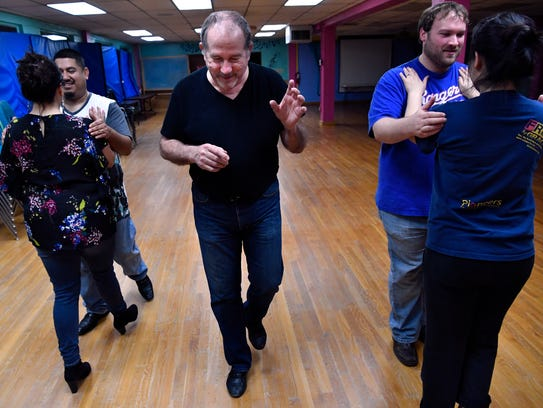 Tim Kormos walks in step between his pupils during his Argentine tango class March 6.