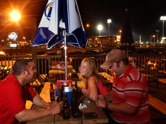 Mike Barrigan, Taelor Brown and Jason Barrigan  have a drink at Brewster Street Ice House after a recent Hooks game at Whataburger Field.