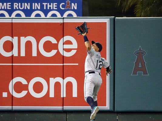 Seattle Mariners center fielder Leonys Martin reaches back to catch a fly ball by Los Angeles Angels' Ji-Man Choi during the second inning of a baseball game in Anaheim, Calif., Thursday, Aug. 18, 2016. (AP Photo/Reed Saxon)