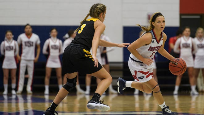 Ohio Dominican's Alexis Overly (3) guards USI's Randa Harshbarger (3) as she dribbles down the court at USI's Phyiscal Activities Center in Evansville, Ind., Thursday, Nov. 16, 2017.
