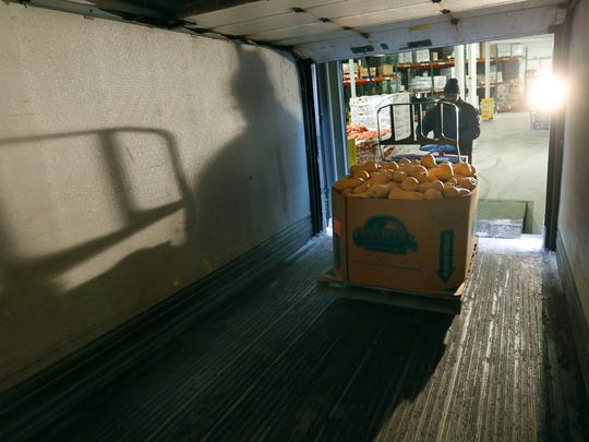 Warehouse manager Perry Jones loads a truck at Foodlink in Rochester. Wintry conditions like we've experienced this year can make food delivery a challenge.