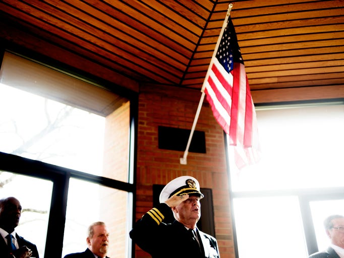 Commander Tommy Mariner sings the national anthem during
