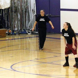 """This photo provided by the Fort Bragg Advocate-News shows Mendocino High School girls basketball wearing the """"I Can't Breathe"""" T-shirts before a recent game."""