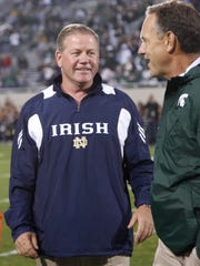 Notre Dame coach Brian Kelly, left, and Michigan State