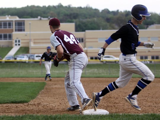 Shippensburg's Teagan Staver, left, tries to make a play against Waynesboro's Kyle Hoffman on Tuesday. The Indians came out on top, 3-0.