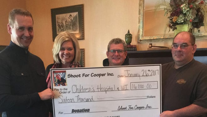 From left: Martin Vogel, head of donations at Children's Hospital, Sara Beaupre, Dan Beaupre and Gerald Fischer — all board members of Shoot For Cooper Inc. The effort recently donated $16,000 to Children's Hospital of Wisconsin.