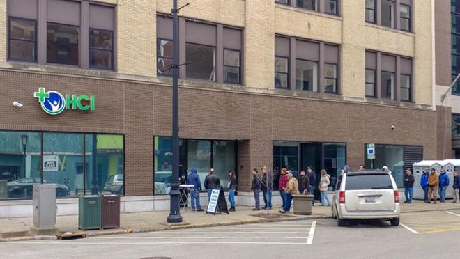 Customers wait in line Jan. 2 outside of HCI Alternatives in Springfield to purchase marijuana for recreational use. In the state's seventh month of legalization, new applicants to the industry have been left in the lurch as the granting of new licenses has been delayed due to the COVID-19 pandemic.