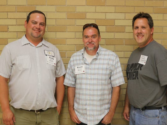 Custodians Andy Seidler, Kevin Davisson and Chris Raboin of the Wausau School District tied for first place in a room safety challenge.