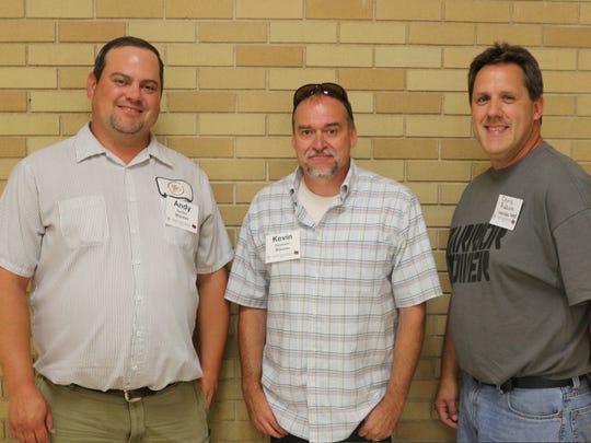 Custodians Andy Seidler, Kevin Davisson and Chris Raboin