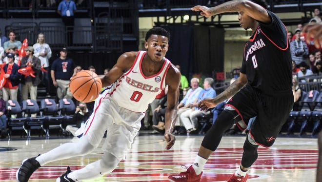 Freshman guard Devontae Shuler, left, scored 14 points and drained four 3s in Ole Miss' win over Louisiana Friday night.