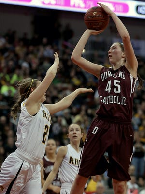 Southeast Polk's #20 Anna Zelenovich, left, defended against Dowling Catholic's #45 Audrey Faber, right, who went up for the shot in Class 5-A championship final basketball game at the 2014 State Girls' Basketball Tournament at Wells Fargo Arena on Saturday night March 8, 2014.