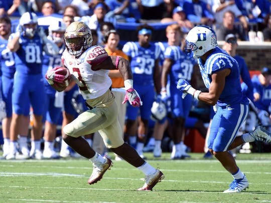 Florida State Seminoles running back Cam Akers (3) runs for a touchdown during the second half against the Duke Blue Devils at Wallace Wade Stadium in Durham. The Seminoles won 17-10.