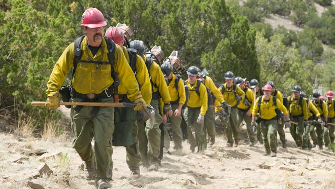 """Supe"" Eric Marsh (Josh Brolin) leads the Granite Mountain Hotshots up the trail at Yarnell Hills--including, generally in this order: Travis Carter (Scott Foxx), Dustin Deford (Ryan Busch), Garret Zuppiger (Brandon Bunch), Andrew Ashcraft (Alex Russell), Wade Parker (Ben Hardy), Scott Norris (producer Thad Luckinbill), Anthony Rose (Jake Picking), Travis Turbyfill (Geoff Stults), Chris MacKenzie (Taylor Kitsch), Brendan McDonough (Miles Teller), Joe Thurston (Matthew Van Wettering), Kevin Woyjeck (Michael McNulty), Grant McKee (Sam Quinn), Billy Warneke (Ryan Jason Cook), John Percin, Jr. (Nicholas Jenks), Sean Misner (Kenny Miller), Robert Caldwell (Dylan Kenin), Clayton Whitted (Scott Haze), Jesse Steed (James Badge Dale) in Columbia Pictures' ""Only the Brave."""