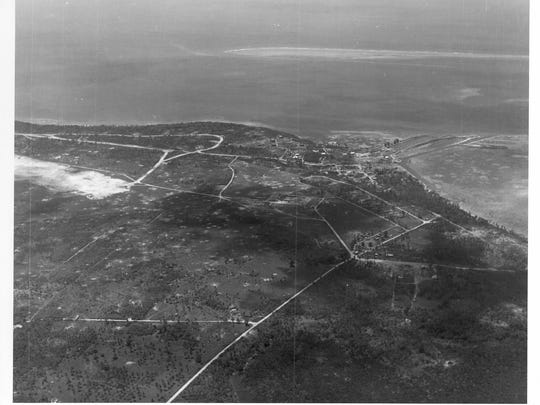 An aerial view (at about a 1,000 foot altitude) of the end of Orote Peninsula airfield and Sumay village, on July 22, 1944.