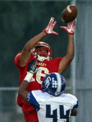 College of the Desert's Kerrion Ringo completes a pass to him for a touchdown against San Bernardino Valley College on Saturday, October 21, 2017 in Palm Desert.