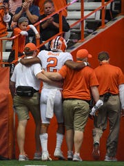 Clemson quarterback Kelly Bryant (2) is helped off the field after receiving a concussion on a sack by by Syracuse defensive lineman Chris Slayton (95) during the 2nd quarter on Friday, Oct. 13, 2017 at the Carrier Dome in Syracuse, N.Y.