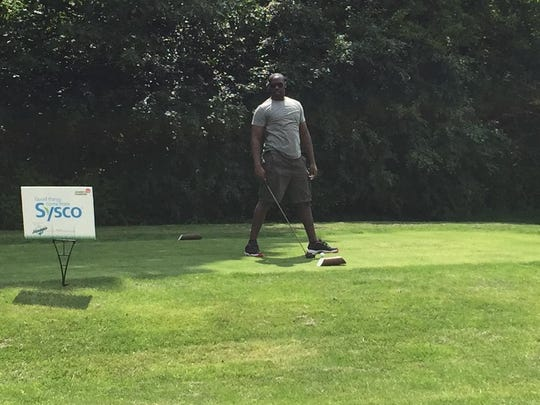 Chandler Jones prepares to tee off on hole No. 15 at