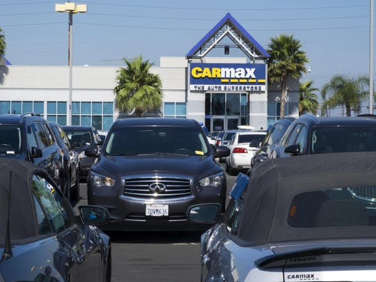 This photo provided by Edmunds shows the lot of a CarMax used-car superstore, in Inglewood, Calif. Unlike most dealerships, CarMax has a no-haggle pricing policy.