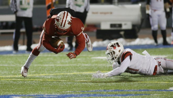 Lakota West wide receiver Mykel Chambers catches a pass during Saturday's game against Huber Heights Wayne.
