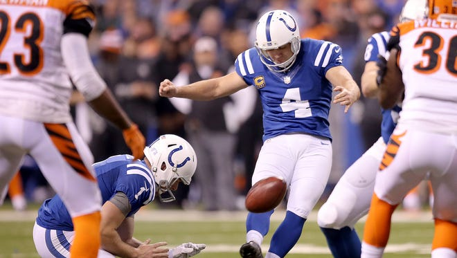 Indianapolis Colts kicker Adam Vinatieri (4) kicks a first half field goal. The Indianapolis Colts host the Cincinnati Bengals in the AFC Wild Card game Sunday, January 4, 2015, afternoon at Lucas Oil Stadium.